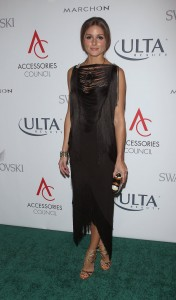 Olivia at ACE Awards with golden lace up sandal