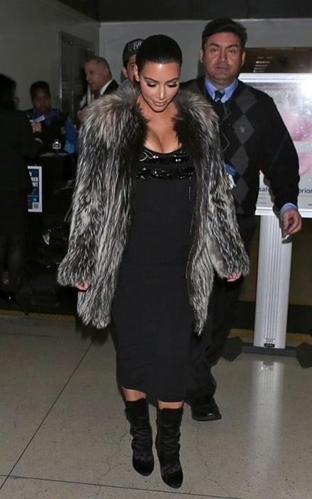 Kim Kardashian Spotted In Balmain Satin Ankle Boots