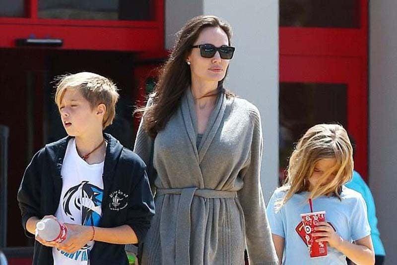 Angelina Jolie flat sandals shopping style