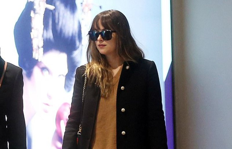 Dakota Johnson leopard print ankle boots
