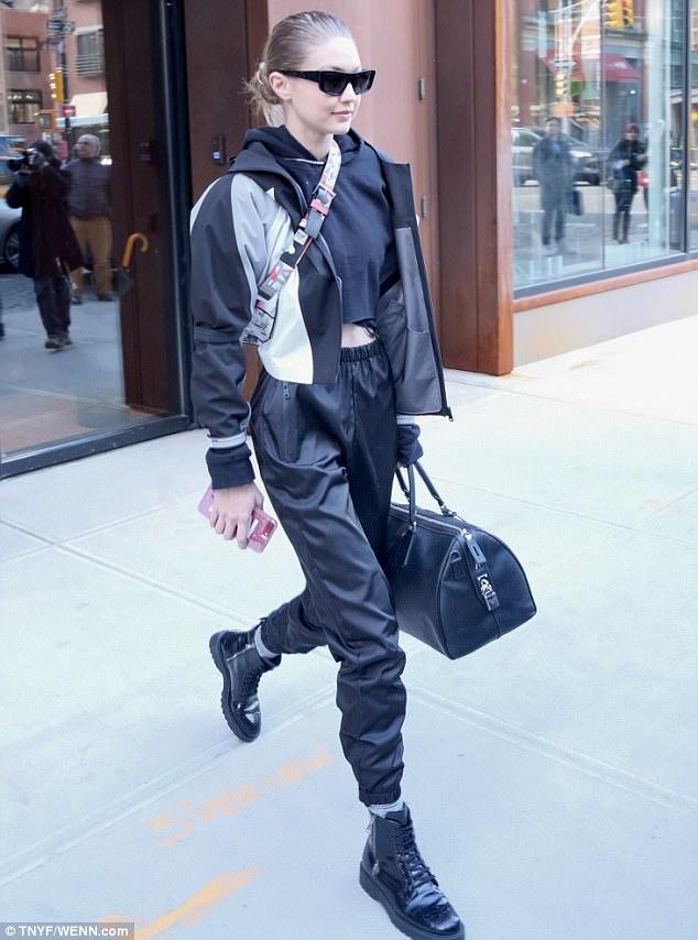 7ea8fabeac56 Gigi Hadid combat boots athleisure style
