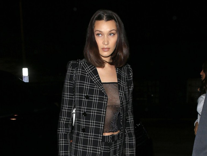 Bella Hadid power suite sneaker style