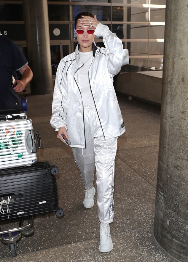 Bella Hadid sneaker airport style