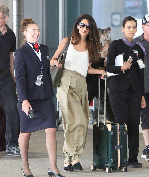 Amal Clooney block heel mule airport style