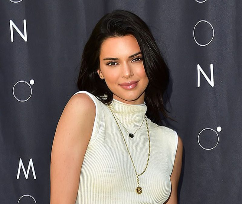 Kendall Jenner yellow snakeskin print boots style